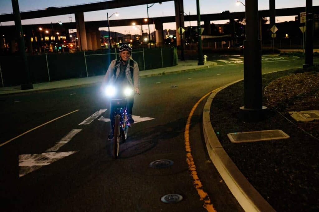 Woman riding an electric bike at sunset